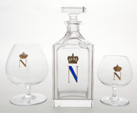 EIGHT BACCARAT GLASS BRANDY SNIFTERS TOGETHER WITH A BRANDY DECANTER WITH ENAMELED MONOGRAM