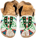 American Indian Art:Beadwork and Quillwork, A PAIR OF SIOUX BEADED HIDE MOCCASINS. c. 1900. ... (Total: 1 Pair)