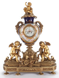 LOUIS XV STYLE GILT BRONZE AND SÈVRES PORCELAIN CLOCK GARNITURE SET France, circa 1900 Marks: Clock Inscribed