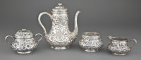 A WHITING FOUR-PIECE SILVER AND SILVER GILT REPOUSSÉ PATTERN TEA SERVICE