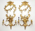 Lighting:Sconces, PAIR OF GILT BRONZE FOUR ARM GIRANDOLES WITH FLORAL GARLAND DRAPED OVER BEVELED MIRROR BACK . France, 20th century. 31-1/2 x 1... (Total: 2 Items)