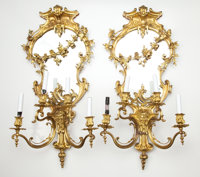 PAIR OF GILT BRONZE FOUR ARM GIRANDOLES WITH FLORAL GARLAND DRAPED OVER BEVELED MIRROR BACK France, 20th century 31-1/...