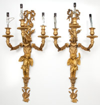 PAIR OF LOUIS XVI STYLE GILT BRONZE THREE ARM SCONCES WITH FLORAL GARLAND AND CHERUB DECORATIONS France, 20th cen