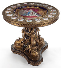 NAPOLEON III STYLE GILT BRONZE, EBONIZED AND PORCELAIN PLAQUE MOUNTED CENTER TABLE France, circa late 19th century