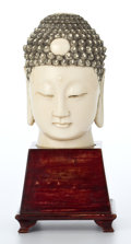 Asian:Chinese, CHINESE CARVED IVORY HEAD OF BUDDHA ON STAND . Circa 1900. 8-1/8inches high (20.6 cm). ... (Total: 2 Items)