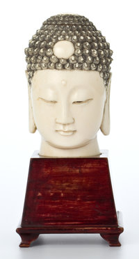 CHINESE CARVED IVORY HEAD OF BUDDHA ON STAND Circa 1900 8-1/8 inches high (20.6 cm)