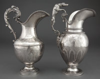 TWO SPANISH SILVER WATER PITCHERS Jacint Carreras, Barcelona, Spain, circa 1880 (one) Marks: N ROSELL, JA CA