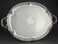 FRENCH SILVER OVAL TWO-HANDLED TRAY WITH CAST RAM'S HEADS AND ENGINE TURNED DECORATION, MONOGRAMMED Circa 1890
