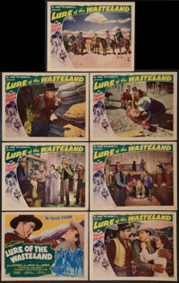 "Lure of the Wasteland (Monogram, 1939). Title Lobby Card and Lobby Cards (6) (11"" X 14""). Western. ... (Total:..."