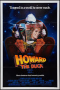 """Movie Posters:Comedy, Howard the Duck (Universal, 1986). One Sheet (27"""" X 41"""") and Press Kit (Multiple Pages) (9"""" X 12""""), with Photos (13) (8"""" X 1... (Total: 15 Items)"""