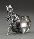 Silver Holloware, American:Napkin Rings, AMERICAN SILVER-PLATED FIGURAL NAPKIN RING; DAPPER YOUNG MAN. Circa 1875. 3-1/2 inches high (8.9 cm). ...