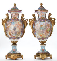 PAIR OF SÈVRES STYLE PORCELAIN URNS AND COVERS WITH GILT BRONZE MOUNTS PAINTED WITH CHERUBIC
