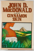 Books:Mystery & Detective Fiction, John D. MacDonald. Cinnamon Skin. The Twentieth Adventure of Travis McGee. New York: Harper & Row, [1982]. First...