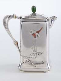 A TIFFANY & CO. SMALL SILVER AND MIXED METAL COFFEE POT Tiffany & Co., New York, New York, circa 1877 Marks: &am...