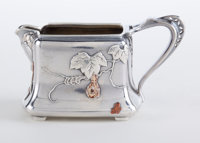 A TIFFANY & CO. SILVER AND MIXED METAL CREAMER Tiffany & Co., New York, New York, circa 1879 Marks: TIFFAN