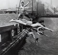 Photographs:20th Century, ARTHUR LEIPZIG (American, b. 1918). Untitled (Divers), circa1948. Gelatin silver, printed later. 15-1/2 x 16-1/4 inches...