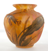 DAUM GLASS VASE Yellow glass etched and enameled in floral motif, circa 1900 Marks: Daum, Nancy, France
