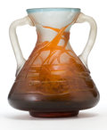 Glass, GALLE GLASS TWO-HANDLED VASE . White glass vase with orange cameo overlay in an aquatic plants motif, circa 1900. Marks: G...