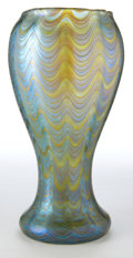 Art Glass:Loetz, LOETZ GLASS VASE . Blue iridescent glass with applied gilt wavemotif, circa 1900. Marks: (crossed arrows) Austria . 9 i...