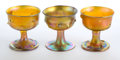 Art Glass:Tiffany , THREE TIFFANY STUDIOS FAVRILE GLASS GOBLETS . Gold Favrile glasspinched goblets, circa 1900. Engraved: LCT. 3-1/2 inche...(Total: 3 Items)