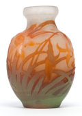 Art Glass:Galle, GALLE GLASS VASE . White glass vase with green and red cameo overlay in an Art Nouveau daffodil motif, circa 1900 . Marks: ...