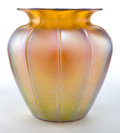 Art Glass:Other , DURAND GLASS VASE . Gold iridescent glass vase with ribs, circa1920 . Engraved: DURAND . 8-1/4 inches high (21.0 cm). ...