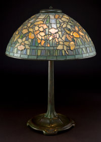 TIFFANY STUDIOS DAFFODIL TABLE LAMP Bronze stick base with three light sockets, green and yellow leaded glass dom
