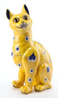 Glass, EMILE GALLE FAIENCE SMILING CAT BOX AND COVER . Yellow and blue faience figural cat box with glass eyes, circa 1890 . Marks:...