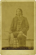 "Photography:Official Photos, RED CLOUD, CHIEF OF PINE RIDGE AGENCY. An unknown photographerproduced this formal 3¾"" x 5½"" image of Chief Red Cloud, wear...(Total: 1 Item)"