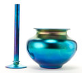 Art Glass:Steuben, TWO STEUBEN GLASS AURENE VASES . Tall blue Aurene glass bud vaseand blue Aurene glass vase with everted lip, circa 1920 . E...(Total: 2 Items)