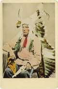 Photography:Cabinet Photos, ATTRACTIVE HAND-TINTED HAYNES CABINET PHOTOGRAPH OF SITTING BULLJR. This handsome ¾-length image of Sitting Bull Jr. has be...(Total: 1 Item)