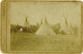Photography:Cabinet Photos, INDIAN CAMP BY D. RODOCKER. Sepia-toned cabinet card of an unidentified Indian encampment, featuring numerous teepees with I... (Total: 1 Item)