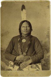 O.S. GOFF CABINET OF RAIN-IN-THE-FACE. Lakota war chief Rain-in-The-Face poses for the camera wearing an ill-fitting mil...