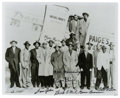 Autographs:Photos, Negro League Stars Multi-Signed Photograph. Shown here is acollection of Negro Leaguers as they board the plane to barnsto...