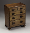 Furniture, A Victorian Walnut Miniature Chest of Drawers. Unknown maker, England. Mid to Late Nineteenth Century. Walnut. Unmarked. 1...