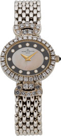 Estate Jewelry:Watches, Baume & Mercier Lady's Diamond, Mother-of-Pearl, White Gold Integral Bracelet Wristwatch. ...