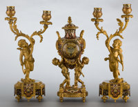 A TIFFANY & CO. THREE-PIECE GILT BRONZE AND ENAMEL CLOCK GARNITURE Tiffany & Co., New York, New York, ci...