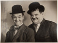 Movie/TV Memorabilia:Memorabilia, A Laurel and Hardy Signed Black and White Photograph, 1929....