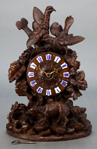 A BLACK FOREST CARVED WOOD MANTLE CLOCK 20th century Marks to mechanism: DC 1756 18-5/8 inches