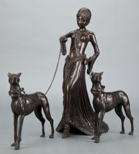 AN ART DECO STYLE PATINATED BRONZE FIGURAL GROUP: LADY WITH DOGS Circa 1930</