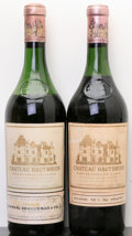 Red Bordeaux, Chateau Haut Brion 1961 . Pessac-Leognan. 1(3.5cm), 1(6cm),1lbsl, 1hbsl, 1wisl, 1ssos. Bottle (2). ... (Total: 2 Btls. )