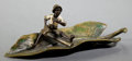 Sculpture, AN AUSTRIAN COLD-PAINTED BRONZE FIGURE: BOY ON A LEAF . 20th century . 7-1/4 inches long (18.4 cm). ...