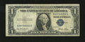 Error Notes:Skewed Reverse Printing, Fr. 1614 $1 1935E Silver Certificate. Fine.. The back printing isaskew....