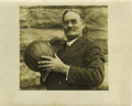 Basketball Collectibles:Others, Circa 1920 James Naismith Photographic Portrait. Iconic image ofthe creator of basketball proudly displaying the tool of t...
