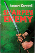 Books:Fiction, Bernard Cornwell. SIGNED. Sharpe's Enemy. London: Collins,[1984]. First edition. Signed by Cornwell on the titl...