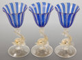 Art Glass:Other , THREE MURANO GLASS GOBLETS WITH DOLPHIN STEMS . 20th century .7-1/2 inches high (19.1 cm). FROM THE ESTATE OF FAYETTA MAR...(Total: 3 Items)