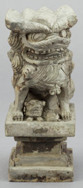 Asian:Chinese, A CHINESE POTTERY FOO DOG . 20th century . 7-1/4 inches high (18.4cm). ...