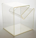 Furniture , A LUCITE MAGAZINE/SIDE TABLE . Circa 1970 . 21-5/8 inches high (54.9 cm). ...