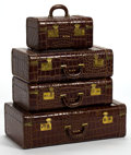 Other:American, FOUR ALLIGATOR SUITCASES . 20th century . 16 inches high (40.6 cm)(largest). ... (Total: 4 Items)