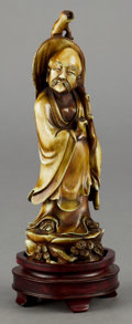 Asian:Chinese, A CHINESE CARVED AND PAINTED IVORY FIGURE OF A SAGE . Circa 1900 .9 inches high (22.9 cm) (including base). ...